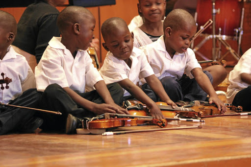 Hands on: The Unisa Music Foundation gives about 1,400 students from disadvantaged backgrounds access to musical instruments and free lessons. Piture: SUPPLIED