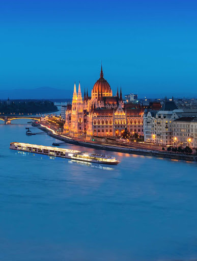 The luxury river ship Scenic Jasper sails through Budapest on the Danube.