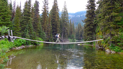 Photo: Greg is crossing the Belly River near Lake Elizabeth - on our way to Red Gap Pass.