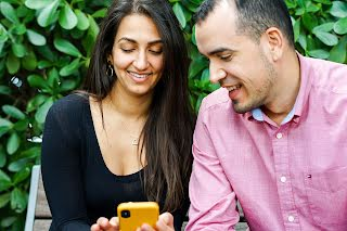 Two People looking into mobile phone