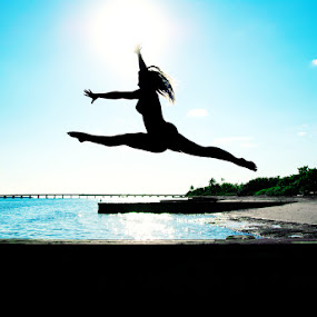 Touch The Sky by James Felix - People Portraits of Women ( girl, pwcsilhouettemotion, female, beautiful, beauty, landscape, sun, jump )