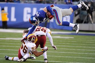 Photo: New York Giants tight end Bear Pascoe jumps over Washington Redskins inside linebacker Perry Riley and cornerback Josh Wilson. Photo by Robert Deutsch, USA TODAY.