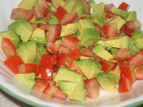 Garnish each serving with the avocado and tomato. This mixture tastes great with flour tortillas....