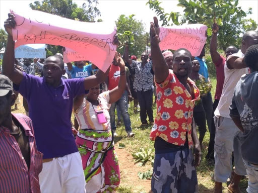 Residents of Jumba Ruins in Mtwapa protest against land grabbers out to push them from their homes, Thursday October 11, 2018. / BRIAN OTIENO