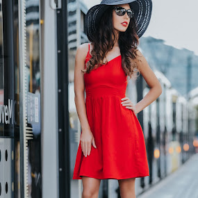 Fashion girl with red dress, black hat and black glasses near a tram in a tram station. by Dragos Iancu - People Portraits of Women ( glasses, beautiful, dress, black, hat, girl, tram, fashion photography, shoes, fashion )