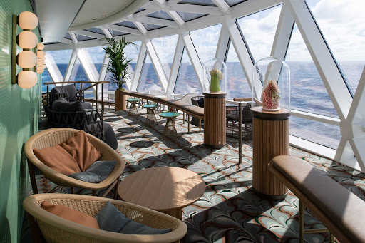 Spread out and relax in the balcony area of the huge Eden lounge aboard your Celebrity Edge class sailing.
