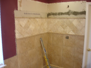"""Photo: shower surround installation W/13X13 porcelain with   2 rows of 6"""" tile installed diagonal trow center."""
