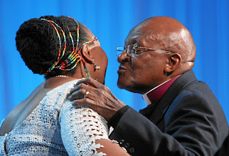 Photo: DAVOS/SWITZERLAND, 25JAN12 -  Yvonne Ntombizodwa Chaka Chaka (L), Singer and President, Princess of Africa Foundation, South Africa and Desmond M. Tutu, Chair, The Elders, South Africa kiss on stage during the Crystal Award Ceremony during the session 'Opening of the Annual Meeting 2012' at the Annual Meeting 2012 of the World Economic Forum at the congress centre in Davos, Switzerland, January 25, 2012.Copyright by World Economic Forumswiss-image.ch/Photo by Remy Steinegger