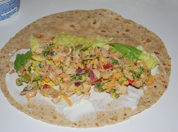 Place tortilla on plate cover half of tortilla with cream cheese.  Then add...