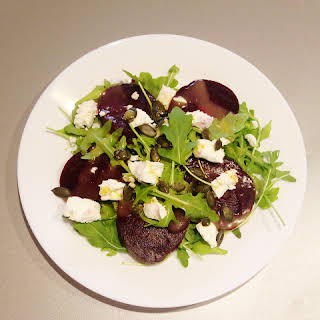 Goat's Cheese and Beetroot Salad with Honey-Mustard Dressing and Pumpkin Seeds.