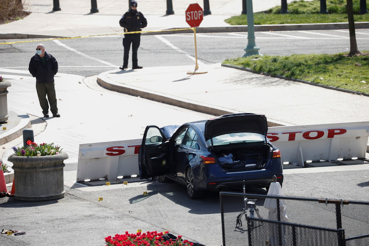 A blue car is seen after ramming a police barricade outside the US Capitol building in an incident that reportedly resulted in the death of one Capitol police officer, the injury of another officer and the death of the driver as a result of police gunfire on Capitol Hill in Washington, US, on April 2 2021.
