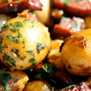 Chorizo-Crisped Potatoes with Pearl Onions and Whole Garlic.