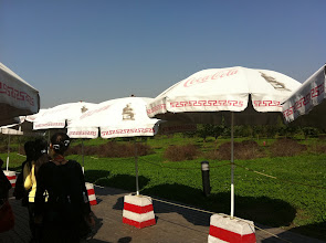 Photo: Coca-Cola / Terracotta umbrellas (and the back of our awesome guide, No-No, in black)