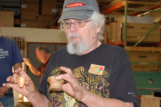 Photo: Ed Karch, our wood ID guy, turned two little forms from wood that Phil Brown had sent him to identify.