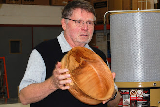 Photo: Richard Webster shows his large bowl with a nice lip and a great spalted detail.
