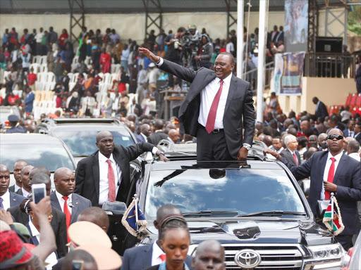 President Uhuru Kenyatta waves to residents at Kinoru Stadium during 2019 Madaraka Day celebrations.