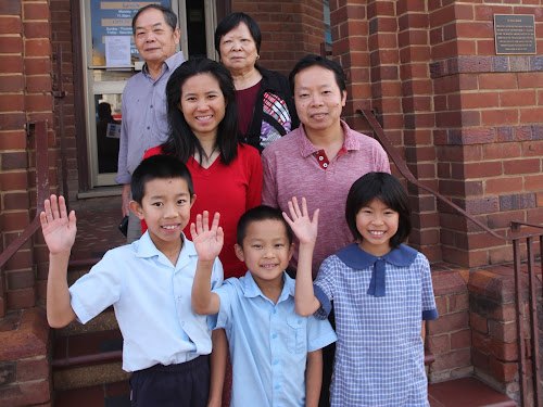 FAMILY FAREWELLED: Back, Kevin's parents Sam and Lily Wu, middle, Shelley and Kevin Wu, front, their children Bobby, 10, Angus 7, and Kelly, 9, on the steps of the family restaurant.