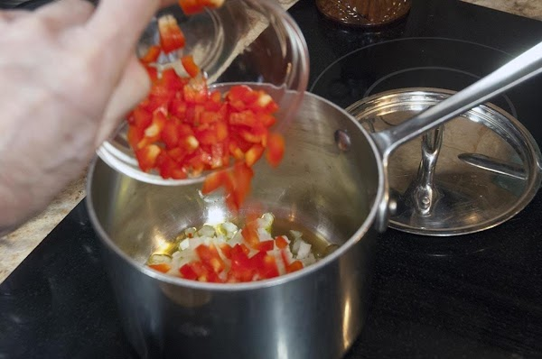 Add the diced onions and red bell pepper.