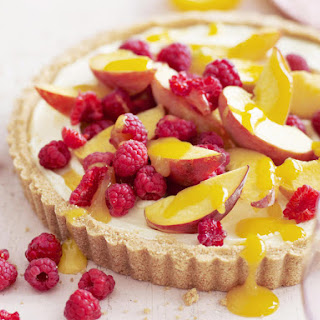 Peach and Raspberry Cheesecake With Mango Coulis