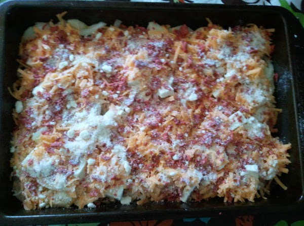 Place cheese on top of potatoes and sprinkle bacocs (optional) on top.