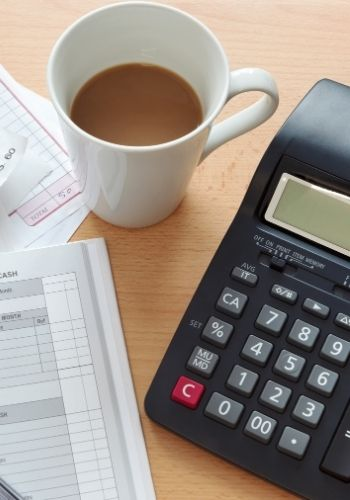 Household Ledger with Coffee and Calculator