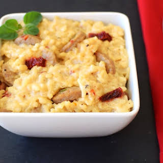 Creamy Dairy-Free Baked Risotto with Italian Sausage and Sun-Dried Tomatoes.