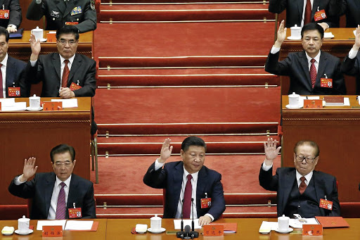 Front row, left to right, former president Hu Jintao, President Xi Jinping and former president Jiang Zemin vote at the closing session of the Communist Party Congress in Beijing on October 24 2017. Picture: REUTERS