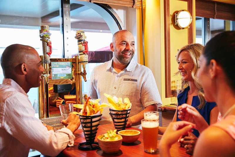 Enjoy private-label brews, appetizers and upbeat tunes from live musicians at RedFrog Pub on your Carnival cruise.