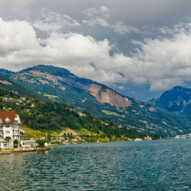 Swiss landscape by Radu Eftimie - Landscapes Mountains & Hills ( boats, switzerland, lake, hotel, alps )