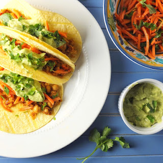Smashed Chipotle Chickpea Tacos With Carrot Slaw And Avocado Crema.