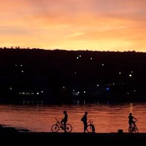 Bikes in suset by Nat Bolfan-Stosic - Landscapes Sunsets & Sunrises ( bikes, children, sunset, bright, sea )