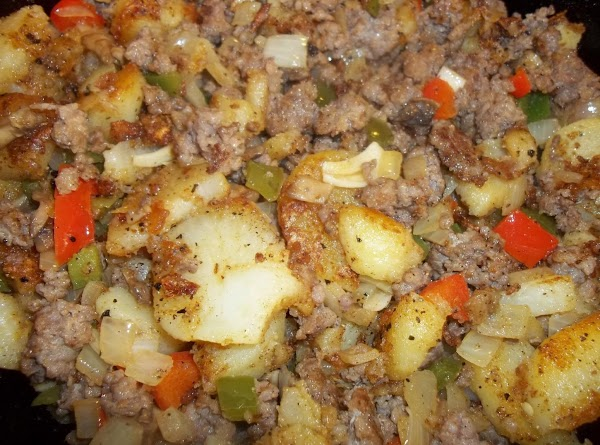 Continue cooking until potatoes are tender and getting brown. Add the crumbled sausage, veggies...