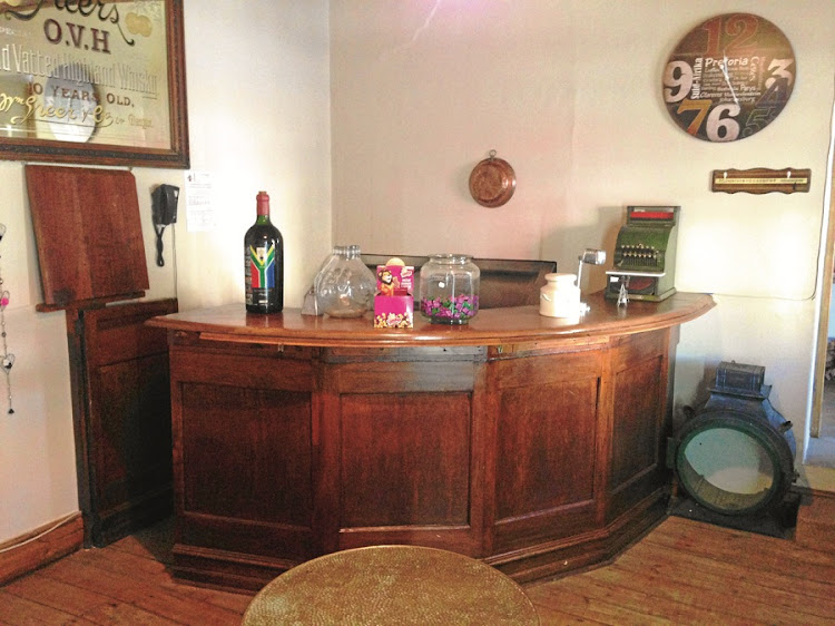 Serving another round. Jimmy's Tavern bar counter in the farm stall. Picture: Tony Jackman