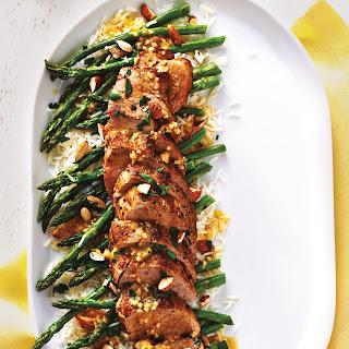 Pork Tenderloin With Roasted Asparagus and Warm Citrus Sauce.