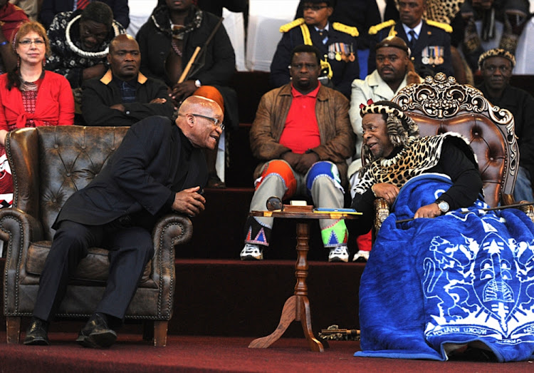 President Jacob Zuma talks with King Goodwill Zwelithini during the the annual reed dance at eNyokeni Royal Palace on September 6, 2015 in KwaNongoma.
