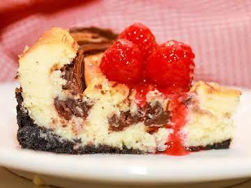 Black & White Cheesecake & Raspberry Coulis