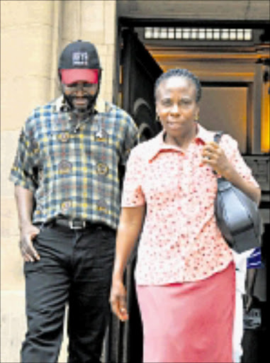 AGGRIEVED: Mathatha Tsedu and Dzudzuzani Netshisaulu outside the Johannesburg high court. Their son was set alight in the boot of his car Pic. Vathiswa Ruselo. © Sowetan