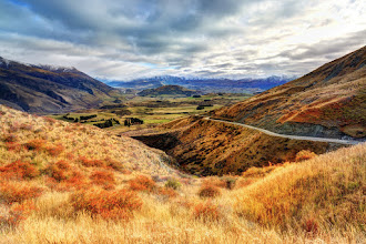 Photo: This is the road in New Zealand that connects Wanaka to Queenstown. It weaves over the Crown Range (near Shania Twain's house, btw) and descends into the valley below where it winds for about 20 kilometers before it finds its way over to Lake Wakatipu and the beginning of Queenstown.