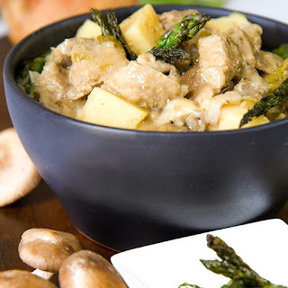 VEAL STEW with asparagus, mushrooms and potatoes.