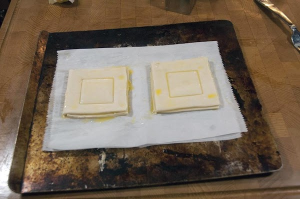 Put the Vol au Vents on a parchment-lined baking sheet.