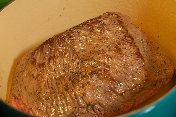 When the oil begins to shimmer, add the roast, and sear on all sides.