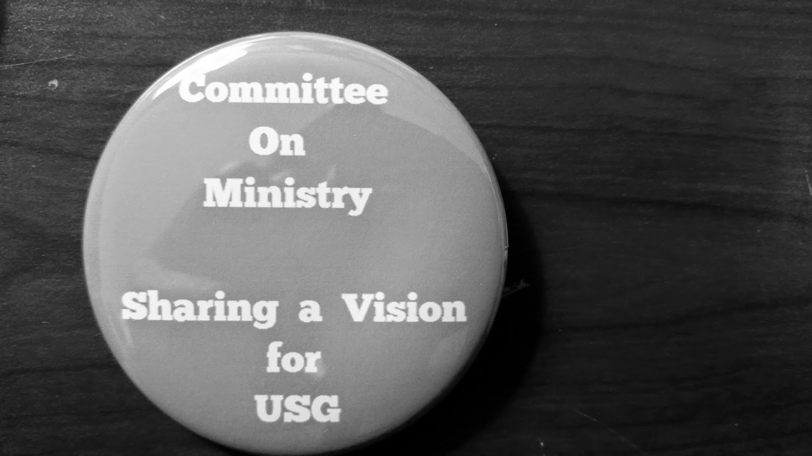 USG AM COM Button.jpg