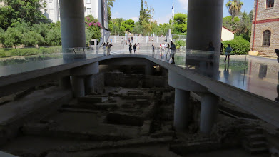 Photo: Construction of the very fancy new Acropolis Museum of course uncovered more ruins. I think you will hit ruins anywhere you dig in Athens. So the walkways are mostly glass. Don't wear a skirt!