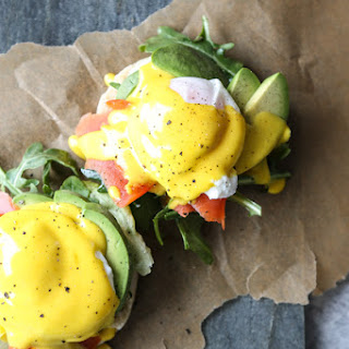 Paleo Eggs Benedict with Smoked Salmon, Garlicky Greens and Turmeric-Ghee Hollandaise.