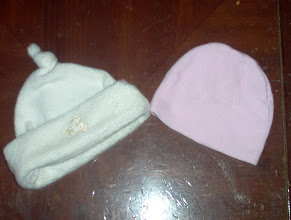 Photo: hats $2.50ppd for white hat,  Pink hat Traded