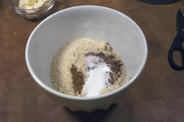 Add all the ingredients for the crust (except the butter) to a large bowl.