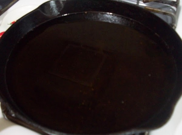 """Heat about 2"""" canola oil in cast iron skillet or dutch oven."""