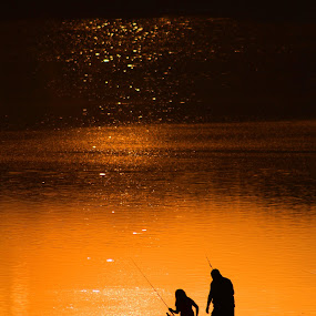 Family Fishing by Cecilia Sterling - People Family ( father and daughter, sunset, lake, fishing, golden hour,  )