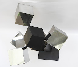 Photo: 30 REFLECTIONS AND A VOID - 58H X 26W X 24D Polished Stainless Steel, Painted Mild Steel, Top View