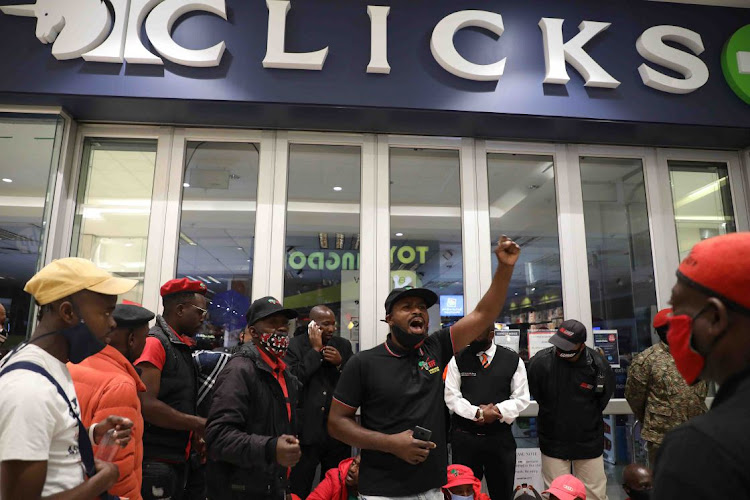 EFF supporters protest outside Clicks in Sandton City Johannesburg. The chain caused an outcry on Friday when it posted an ad on its website depicting black hair as dry and damaged, blonde hair fine and flat.
